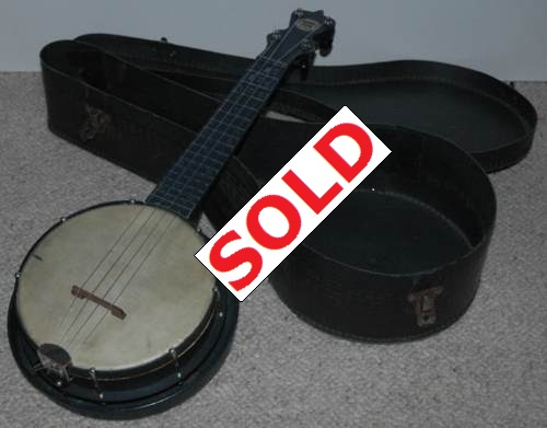 'Jolly Joe' cast metal novelty banjolele.